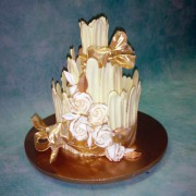 Chocolate Fence Wedding Cake with Gold Touched Roses