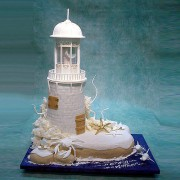 Lighthouse And Dolphins Wedding Cake