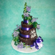 Chocolate Wedding Cake with Purple Fresh Flowers