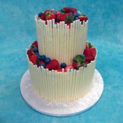 Chocolate Stick Fence Wedding Cake with Fresh Berries