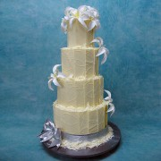 4 Tier Chocolate Wedding Cake with Chocolate Panels And Lilies