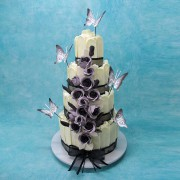White Chocolate Fence Wedding Cake with Purple Roses And Butterflies