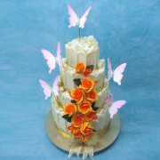 White Chocolate Fence Wedding Cake with Orange Roses And Butterflies
