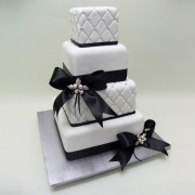 4 T Quilt And Black Ribbon Cake