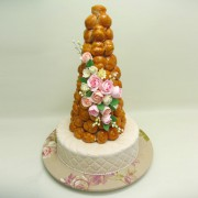 Profiterole on Cake with Pink Flowers