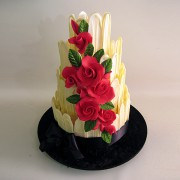 Chocolate Fence Wedding Cake with Red Roses