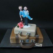 Couple on Luggages Wedding Cake