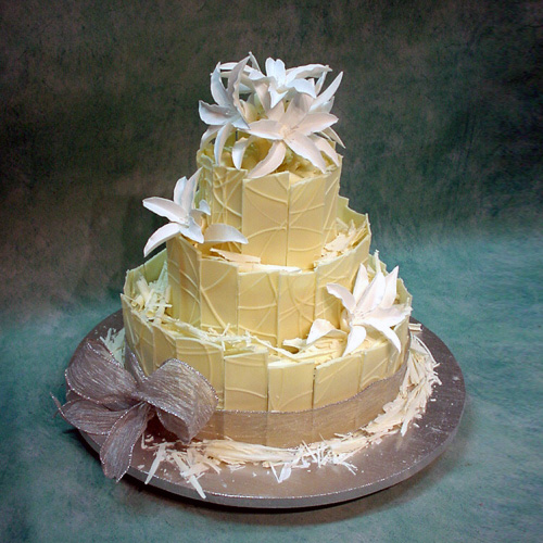 Image of wedding Cake With Chocolate Panels And White Lilies
