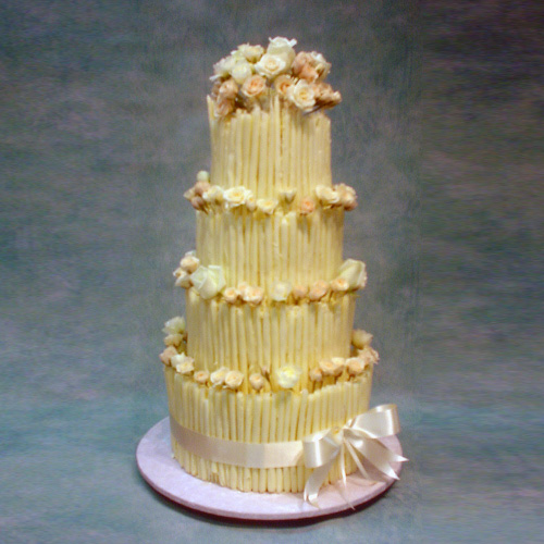 4-tier-wedding-cake-with-chocolate-cigars