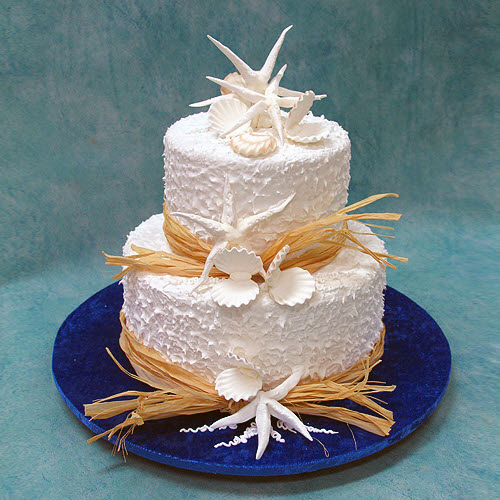2 tier beach wedding cake with straw ribbon
