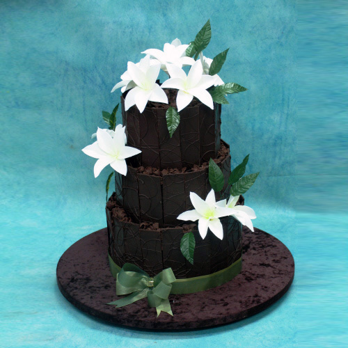 Image of dark Chocolate Panels Wedding Cake With Sugar Lilies