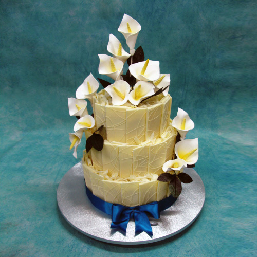 Image of chocolate Wedding Cake With Chocolate Panels And Calla Lilies